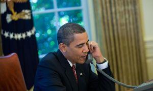 US President Barack Obama talks on the p