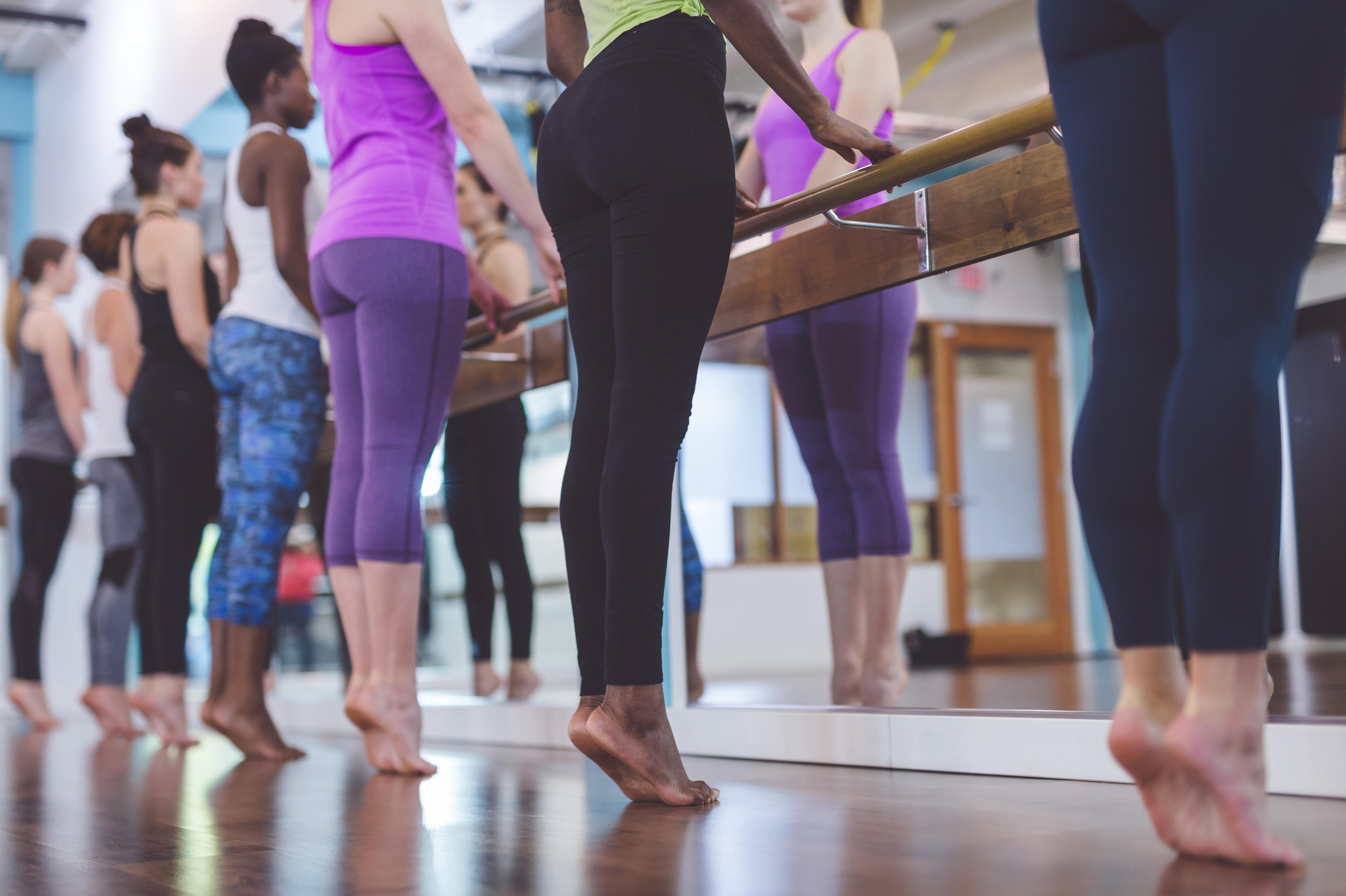 Group of Women Doing Barre + TRX Workout