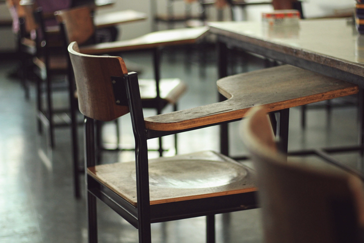 Empty Chairs With And Table In Classroom