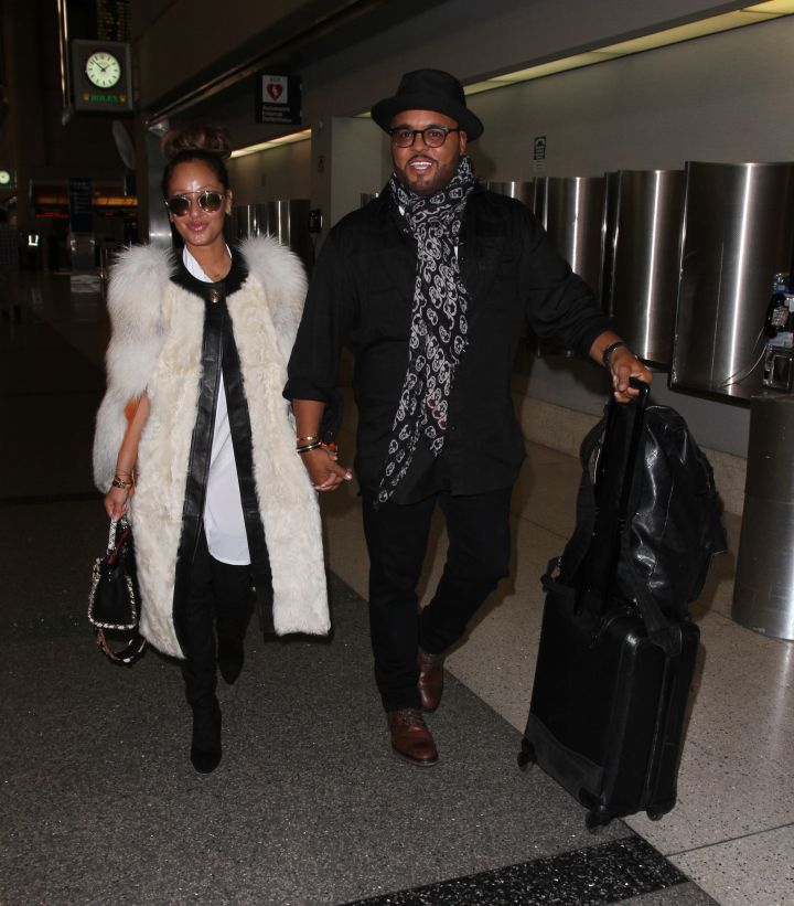 Adrienne Bailon and her fiancé Israel Houghton depart from Los Angeles International Airport (LAX)