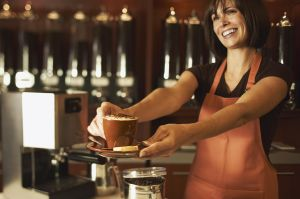 Clerk presenting cappuccino