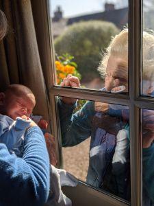 New Mum Introduces Newborn Son to Grandmother Through Glass Window on Mother Sunday